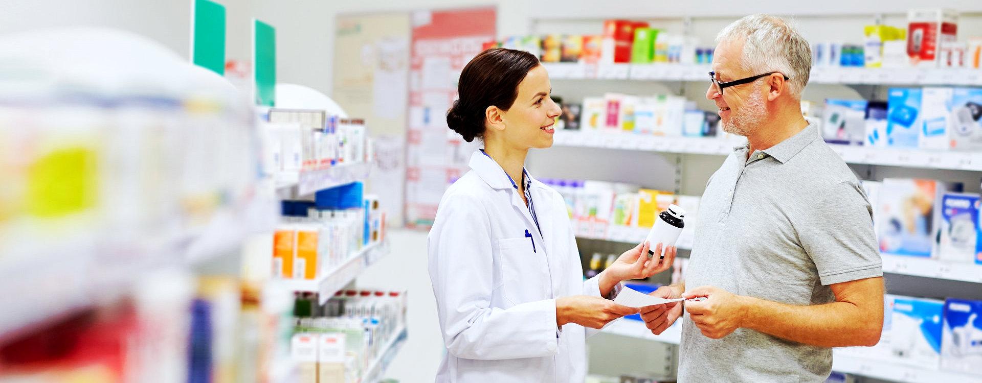 pharmacist talking to a senior man